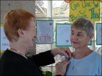 Sr. Immaculata pins Kathleen Devitt, at the Associate Commissioning