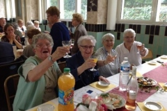 A toast in the name of the Holy Cross Family.